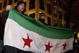 Syrian antithesis urges mass protests after university raid