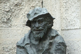 Karabala statue changed behind to Yerevan's Abovian street